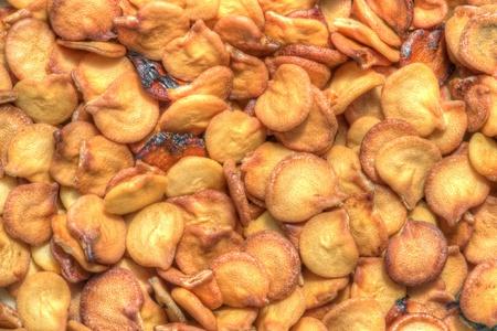Macro closeup of pile of dry chili pepper seeds