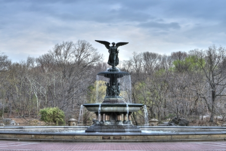 Beautiful Bethesda fountain in Central Park, New York on an early spring morning with bare trees in background photo