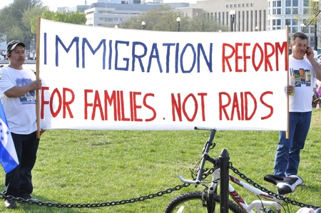 demonstrators: Washington D.C. - April 10, 2013: Demonstrators display a large banner calling for immigration reform during a rally in front of the capitol in Washington D.C. on April 10, 2013