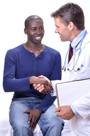 Young male patient shakes hands with his doctor during medical examination on white background