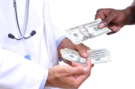 Closeup of doctors hands full of money as he demands more pay from uninsured patient on white background Stock Photo