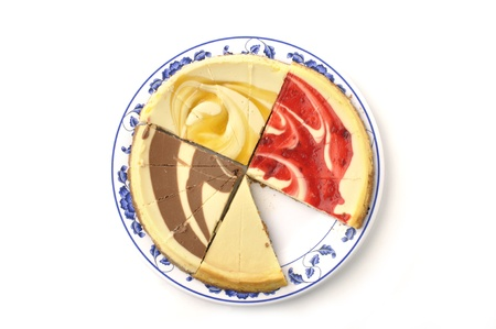 flavored: Superior angle of colorful plate of sliced cheese cake with different flavored toppings on white background
