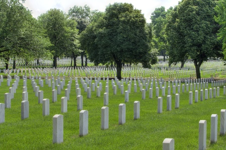 MINNEAPOLIS, MN - JUNE 29, 2013: Rows of tombstones mark the memories of soldiers that served since 1870 at the Fort Snelling National Cemetery in Minneapolis, Minnesota