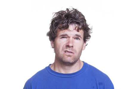 and the horizontal man: Mugshot of messy scruffy drunk Caucasian man on white background Stock Photo