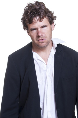 inebriated: Mugshot of messy scruffy drunk Caucasian man on white background Stock Photo