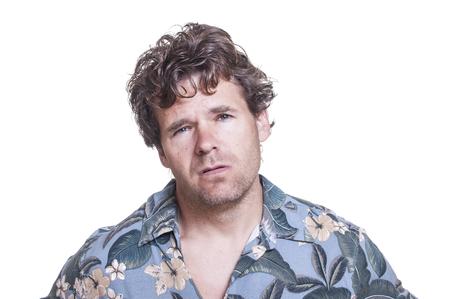 Mugshot of repulsive messy scruffy drunk Caucasian man on white background