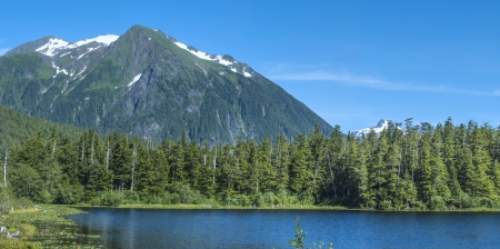 Beautiful summer daytime panoramic of Heart Lake and Bear Mountain amidst the pine forests of southeast Alaska near Sitka Stock Photo - 23412702