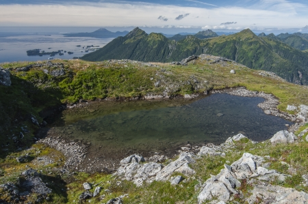 Transparent freshwater pool on top of Bear Mountain on beautiful Baranof Island, Alaska with Sitka, Mount Verstovia, and Mount Edgecumbe in background Stock Photo - 23482749