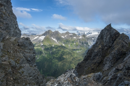 Beautiful snow-capped mountain range of Baranof Island, Alaska during the summer of 2013 viewed from peak of Bear Mountain Stock Photo - 23482757
