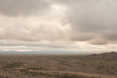 recently: Dark landscape and rain clouds of Arizona desert recently after heavy rainfall