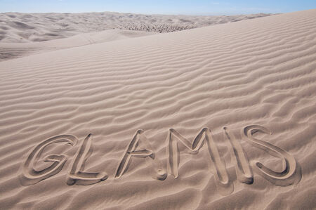 atc: The letters GLAMIS written in desert of Imperial Sand Dunes on hot sunny day