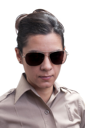 deputy: Closeup portrait of pretty young Hispanic female sheriff in uniform and dark shades on white background