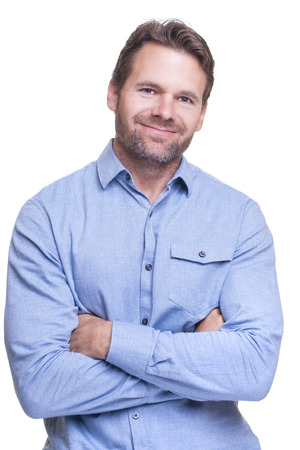 rugged: Portrait of handsome rugged bearded Caucasian man with folded arms smiling on white background