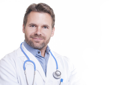scruffy: Portrait of handsome male bearded Caucasian doctor smiling wearing lab coat on white background with copy space