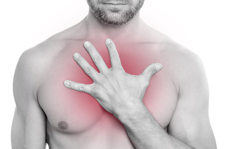 Closeup of shirtless bearded muscular Caucasian man with chest pain; pressing hand on chest on white background Stock Photo - 24384627