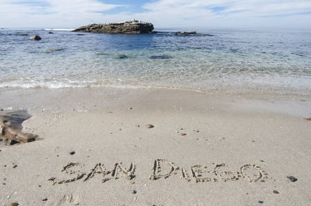 The letters SAN DIEGO written in sand on beautiful San Diego beach in La Jolla, California Stock Photo