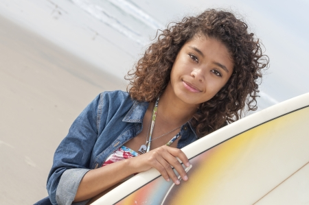 latina girl: Head shot of beautiful young latina surfer girl with beautiful smile and surf board on beach