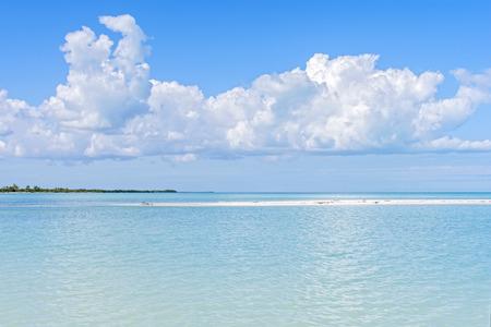 hues: Beautiful hues of blue and green at mouth of Chacmuchuc lagoon on Caribbean Sea at Isla Blanca, Quintana Roo, Mexico Stock Photo