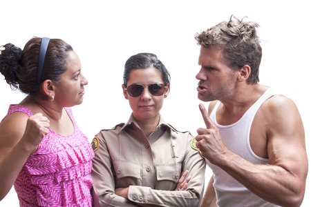 Female sheriff deputy stands with arms crossed between angry Caucasian man and Hispanic woman couple in heated argument on white background photo