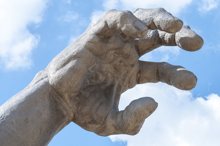 Giant cast iron sculptured hand of the Awakening sculpture at National Harbor, Maryland