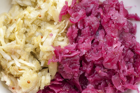 Macro closeup of green and red homemade fermented sauerkraut side by side Stock Photo