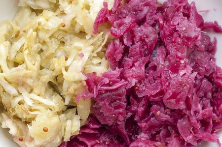Macro closeup of green and red homemade fermented sauerkraut side by side Standard-Bild
