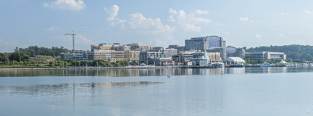 commercialization: Panoramic of National Harbor riverfront looking across Potomac Riveri in Maryland on sunny day Editorial