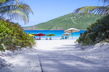Wooden walkway leads to beautiful tropical sandy Flamenco Beach on the Puerto Rican island of Culebra