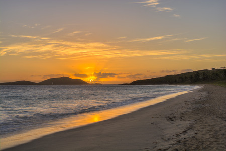 Magnificent orange sunrise over tropical Caribbean island of Culebrita as seen from Zoni Beach, Culebra, Puerto Rico Stock Photo