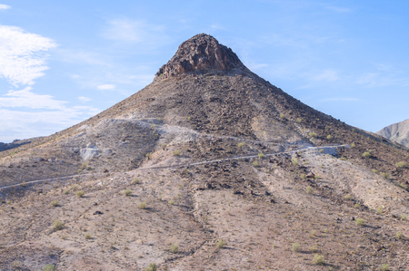 rocky peak: Rugged rocky peak of Dome Rock mountain on hot summer day in La Paz county, Arizona Stock Photo