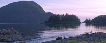 Beautiful panoramic scenic seascape on beach of Herring Cove in Silver Bay near Sitka, Alaska at sunset