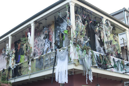 bourbon street: NEW ORLEANS, USA - OCTOBER 10, 2014: The upper balcony of a house on Bourbon Street is heavily decorated for Halloween with ghouls, ghosts and skulls.