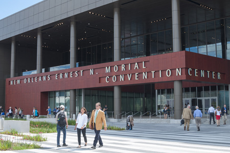NEW ORLEANS, USA - OCTOBER 12, 2014: Attendees and exhibitors going about business in front of the New Orleans Ernest N. Morial Convention Center during the annual meeting of the American Society of Anesthesiologists. Editorial