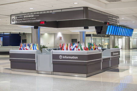 acknowledge: ATLANTA, USA - OCTOBER 14, 2014: The information desk at the Atlanta International Airport is adorned with small flags of many nations to acknowledge travelers from around the world. Editorial