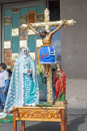 homage: MEXICO CITY, MEXICO - OCTOBER 23, 2014: Beautiful statues featuring Jesus Christ on the cross and the Holy Mother Mary on display after mass in front of the Basilica of Our Lady of Guadalupe in Mexico City.