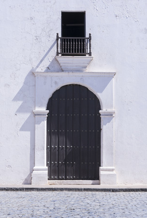 16th century: 16th century Spanish Gothic architecture represented in front entrance door of San Jose Church in Old San Juan, Puerto Rico Stock Photo