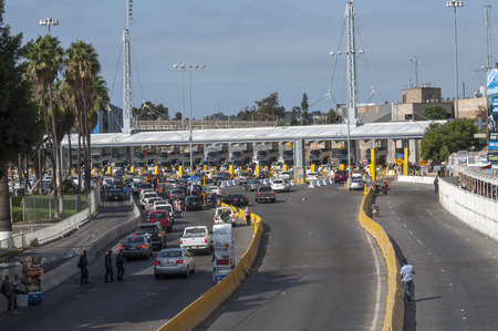 TIJUANA, MEXICO - NOVEMBER 13, 2014: The auto lanes at the Tijuana border crossing surprisingly have extremely short lines on this particular morning Editorial