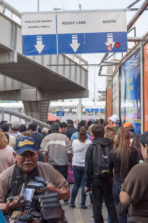 existence: TIJUANA, MEXICO - NOVEMBER 13, 2014: Despite the existence of three seperate lines, the pedestrian border crossing from Tijuana, Mexico to the United States remains a long wait