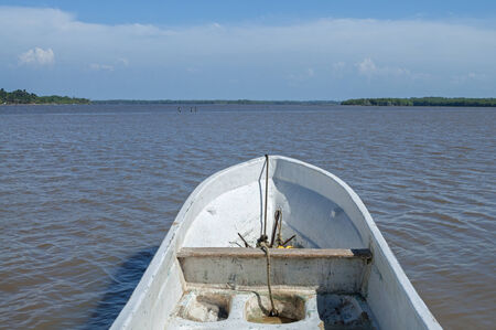 Point of view from inside fiberglass Mexican panga boat on river in Veracruz, Mexico on sunny day Stock Photo - 34313917