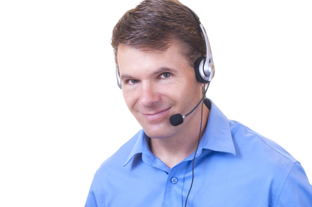 customer service representative: Closeup portrait of handsome smiling Caucasian man wearing headset while working as a customer service representative on white background