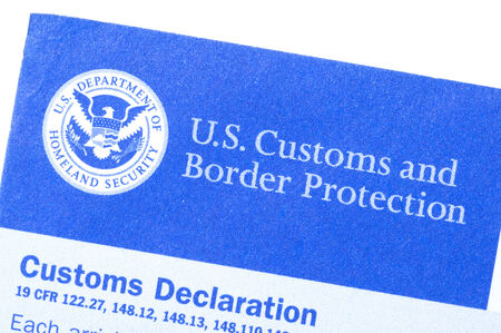 Macro closeup of U.S. Customs and Border Protection declaration form and title on white background