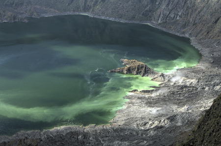 vents: Vapor and gas vents and green colored water in interior of active barren volcanic crater El Chichonal in Chiapas, Mexico on December 19, 2014