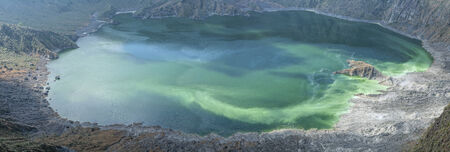 Panoramic of emerald green sulfur-rich water of lake in crater of active volcano El Chichon in Chiapas, Mexico on December 19, 2014