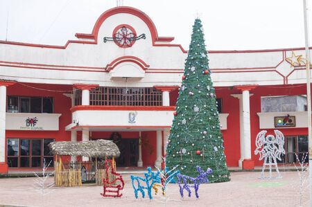 public spirit: CHAPULTENANGO, CHIAPAS, MEXICO - DECEMBER 19, 2014: Traditional Christmas decorations are neatly on display in front of the city hall in the rural town of Chapultenango in the state of Chiapas