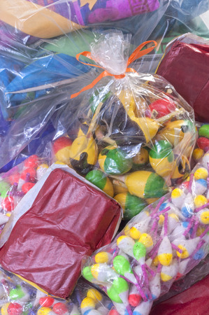 Pile of variety of colorful packaged Mexican firecrackers