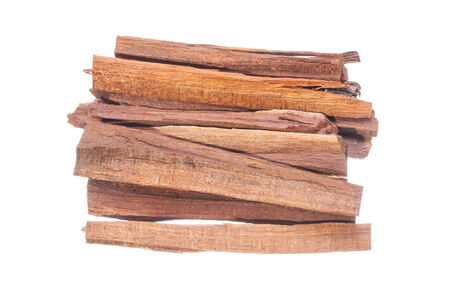 logwood: Small stack of pieces of Haematoxylum brasiletto Mexican logwood for making tea isolated on white background