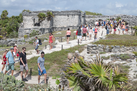 TULUM, MEXICO - JANUARY 23, 2015: Tulum is a popular tourist destination on the Mexican Riviera and the Maya ruins archaeological park often attracts hundreds of foreign visitors daily
