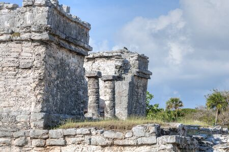 archaeology: East side wall and columns of House of the Chultun in the Maya ruins archaeology site of Tulum on the Mexican Riviera