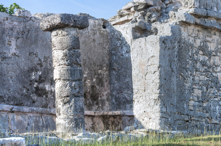 archaeology: Stone column on east side of House of the Chultun in Maya ruins archaeology site on Mexican Riviera