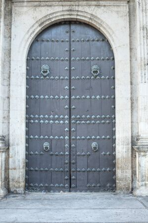 massive: Massive wooden front doors of Cathedral of Ildefonso in Merida, Mexico